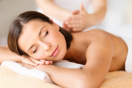 47304411 - health, beauty, resort and relaxation concept - beautiful woman with closed eyes in spa salon getting massage